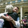 City council candidate Mel Wymore getsa hug after a gun law rally on Friday, June 14, 2013 on the steps of New York City Hall. If Wymore wins a council seat it would mark the first transgender officeholder for the city. (AP Photo/Bebeto Matthews)