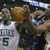 Photo -   Boston Celtics power forward Kevin Garnett (5) battles for a loose ball with Utah Jazz center Al Jefferson (25) during the first half of an NBA basketball game in Boston, Wednesday, Nov. 14, 2012. (AP Photo/Elise Amendola)