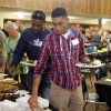 Photo - Edmond employee John Byron, left, and, his son, Stephen, go through the buffet line at an appreciation dinner hosted by the city staff.