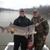 Mustang High School soccer coach Jared Homer and his father, Brad, show off a 65-pound spoonbill caught recently on the Grand River in northeast Oklahoma. The spoonbills, or paddlefish, have started their annual spring spawning runs in the Grand River system. PHOTO PROVIDED
