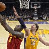 Photo - Cleveland Cavaliers forward Luol Deng puts up a shot as Los Angeles Lakers center Pau Gasol defends during the first half of an NBA basketball game, Tuesday, Jan. 14, 2014, in Los Angeles. (AP Photo/Mark J. Terrill)