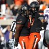 Oklahoma State\'s Tyler Johnson (40) and Lyndell Johnson (27) celebrate a sack on Daniel Sams (4) during the second half of a college football game between the Oklahoma State University Cowboys (OSU) and the Kansas State University Wildcats (KSU) at Boone Pickens Stadium in Stillwater, Okla., Saturday, Oct. 5, 2013. OSU won 33-29.Photo by Sarah Phipps, The Oklahoman