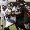 Star Spencer quarterback Franky Jamison (9) tries to get away from a gang of Douglass defenders during the Class 4A high school football state championship game between Star Spencer and Douglass at Boone Pickens Stadium in Stillwater, Okla., Saturday, December 5, 2009. Star Spencer won, 34-21. Photo by Nate Billings, The Oklahoman