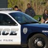 Photo -   People watch police investigate the scene where three people were shot and killed at an in-home day care in Brooklyn Park, Minn., on Monday, April 9, 2012. No arrests were immediately made. (AP Photo/The Star Tribune, Richard Sennott) MANDATORY CREDIT; ST. PAUL PIONEER PRESS OUT; MAGS OUT; TWIN CITIES TV OUT