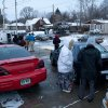 Friends and family members gather outside the home where two parents were found dead, Tuesday, Dec. 25, 2012 in Flint, Mich. Authorities say five people are dead in two separate incidents of what is believed to be accidental carbon monoxide poisoning. (AP Photo/Flint Journal, Griffin Moores)
