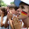 Paul Schwerin, 12, of Saarland, Germany, watches the US-Germany World Cup soccer match during a viewing party sponsored by the German Embassy, Thursday, June 26, 2014, in Dupont Circle in Washington. (AP Photo/Connor Radnovich)