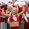 Members of the Oklahoma cheer squad greet the football team as they arrive to the stadium during the Red River Rivalry college football game between the University of Oklahoma Sooners (OU) and the University of Texas Longhorns (UT) at the Cotton Bowl Stadium in Dallas, Saturday, Oct. 12, 2013. Photo by Chris Landsberger, The Oklahoman