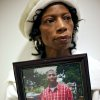 JoNita Normore poses with a picture of her son Ra\'Mon as she talks about his murder at a coffee shop in Oklahoma City on Tuesday, Dec. 28, 2010. Ra\'Mon was killed in 2009. Photo by John Clanton, The Oklahoman