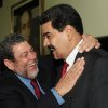 In this photo released by Miraflores Press Office, Venezuela\'s Vice President Nicolas Maduro, right, is greeted by Prime Minister of Saint Vincent and the Grenadines Ralph Gonsalves during a meeting in Caracas, Venezuela, Wednesday, Jan 9, 2013. (AP Photo/Miraflores Press Office)