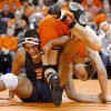 Oklahoma State\'s Blake Rosholt wrestles Mario Gonzalez of Illinios in the 197-pound match of the NWCA National Duals semifinals wrestling at Gallagher-Iba Arena in Stillwater, Okla., Sunday, Feb. 19, 2012. Oklahoma State won 19-15. Photo by Bryan Terry, The Oklahoman