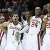From left to right, Oklahoma\'s Jordan Woodard, Frank Booker, Je\'lon Hornbeak, Buddy Hield and Cameron Clark, celebrate on the bench late in the second half of an NCAA college basketball game against Baylor in Norman, Okla., Saturday, Feb. 8, 2014. Oklahoma won 88-72. (AP Photo/Sue Ogrocki)