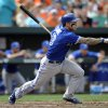 Toronto Blue Jays\' Brett Lawrie follows through on a single against the Baltimore Orioles in the fourth inning of a baseball game on Sunday, April 13, 2014, in Baltimore. (AP Photo/Gail Burton)