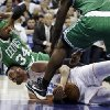 Charlotte Bobcats\' Byron Mullens (22) holds onto the ball as Boston Celtics\' Paul Pierce (34) falls on him during the first half of an NBA basketball game in Charlotte, N.C., Monday, Feb. 11, 2013. (AP Photo/Chuck Burton)