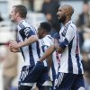 Photo - West Bromwich Albion's Nicolas Anelka, right, gestures as he celebrates his goal against West Ham United during their English Premier League soccer match at Upton Park, London, Saturday, Dec. 28, 2013. (AP Photo/Sang Tan)
