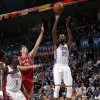 Oklahoma City\'s Kevin Durant (35) shoots as Houston\'s Chandler Parsons (25) defends during the NBA basketball game between the Oklahoma City Thunder and the Houston Rockets at the Chesapeake Energy Arena, Tuesday, March 13, 2012. Photo by Sarah Phipps, The Oklahoman.