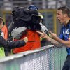 Photo - Atalanta's German Denis, right, of Argentina, celebrates his second goal with his son Matias during a Serie A soccer match against Napoli in Bergamo, Italy, Sunday, Feb. 2, 2014. (AP Photo/Felice Calabro')