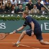 Photo - Russia's Dmitry Tursunov returns the ball during the third round match of the French Open tennis tournament against Switzerland's Roger Federer at the Roland Garros stadium, in Paris, France, Friday, May 30, 2014.  (AP Photo/Michel Euler)
