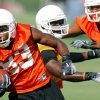 Wide receiver Artrell Woods runs upfield after making a catch during the first Oklahoma State University fall football practice, in Stillwater, Okla., Thursday, July 31, 2008. BY MATT STRASEN, THE OKLAHOMAN