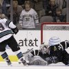 Photo -   Dallas Stars goalie Kari Lehtonen (32), of Finland, blocks a shootout attempt by San Jose Sharks center Logan Couture (39) in an NHL hockey game Thursday, March 8, 2012, in Dallas. The Stars won in overtime 4-3. (AP Photo/Tony Gutierrez)