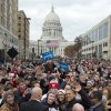 With the Wisconsin state capitol dome as a backdrop, President Barack Obama waves to the press as he greets supporters at a campaign event, Monday, Nov. 5, 2012, in downtown Madison, Wis. (AP Photo/Carolyn Kaster)
