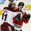 Phoenix Coyotes goalies Mike Smith, left, fights with Chicago Blackhawks\' Andrew Shaw during the third period of an NHL hockey game in Chicago, Thursday, Nov. 14, 2013. The Blackhawks won 5-4. (AP Photo/Nam Y. Huh)