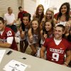 COLLEGE FOOTBALL: Sooner cheer squad members pose with guarterbacks Blake Bell, left, and Trevor Knight during fan appreciation day for the University of Oklahoma Sooner (OU) football team at Gaylord Family-Oklahoma Memorial Stadium in Norman, Okla., on Saturday, Aug. 3, 2013. Photo by Steve Sisney, The Oklahoman