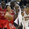 Photo -   Houston Rockets point guard Jeremy Lin, front left, is fouled by Atlanta Hawks power forward Anthony Tolliver (4) while driving in the first half of an NBA basketball game on Friday, Nov. 2, 2012, in Atlanta. (AP Photo/John Bazemore)