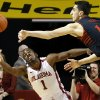 Texas Tech\'s Dejan Kravic (11) passes the ball over Oklahoma\'s Sam Grooms (1) during an NCAA college basketball game between the University of Oklahoma and Texas Tech University at Lloyd Noble Center in Norman, Okla., Wednesday, Jan. 16, 2013. Photo by Bryan Terry, The Oklahoman