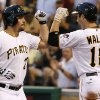 Photo - Pittsburgh Pirates' Travis Snider, left, celebrates with teammate Neil Walker (18) as he returns to the dugout after hitting a solo home run off Los Angeles Dodgers starting pitcher Dan Haren during the second inning of a baseball game in Pittsburgh, Wednesday, July 23, 2014. (AP Photo)