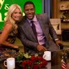 Photo -   Former football player Michael Strahan, right, poses Kelly Ripa on the set of the newly named