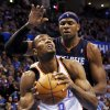 Oklahoma City\'s Serge Ibaka (9) tries to get the ball past Charlotte\'s Brendan Haywood (33) during an NBA basketball game between the Oklahoma City Thunder and Charlotte Bobcats at Chesapeake Energy Arena in Oklahoma City, Monday, Nov. 26, 2012. Photo by Nate Billings , The Oklahoman