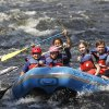 Photo - FILE - This Aug. 5, 2011 file photo shows whitewater rafters going down the Sacandaga River in Lake Luzerne, N.Y.  Activities like whitewater rafting, ziplining, surfing and stand-up paddleboarding often appeal to teenagers, even when they're at the age where they're not all that excited about vacationing with their parents. Being flexible about itineraries, letting teens help plan outings and including activities that they'll enjoy can make traveling with teens more fun for everyone. (AP Photo/Mike Groll, File)