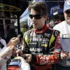 Photo - Driver Jeff Gordon signs autographs for fans as he walks to his garage during practice for Sunday's NASCAR Sprint Cup Series auto race at Chicagoland Speedway in Joliet, Ill., Friday, Sept. 13, 2013. (AP Photo/Nam Y. Huh)