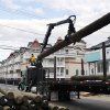 Yuri Pismennyi unloads 36 poles to be used as pilings to rebuild the boardwalk in Seaside Heights, N.J., Thursday, April 25, 2013. Six months after Superstorm Sandy devastated the Jersey shore and New York City and pounded coastal areas of New England, the region is dealing with a slow and frustrating, yet often hopeful, recovery. (AP Photo/Mel Evans)