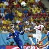Photo - Greece's Kostas Mitroglou falls over Costa Rica's goalkeeper Keylor Navas after his shot on goal was blocked by Mitroglou in extra time during the World Cup round of 16 soccer match between Costa Rica and Greece at the Arena Pernambuco in Recife, Brazil, Sunday, June 29, 2014. (AP Photo/Martin Meissner)