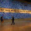 Photo - FILE - In this May 15, 2014 file photo, a quote from Virgil fills a wall of the museum prior to the dedication ceremony at the National September 11 Memorial Museum in New York. The museum was designed with the psychological well-being of the public in mind.  But behind the wrenching sights and sounds of the National Sept. 11 Memorial Museum lies a quiet effort to help visitors handle its potentially traumatic impact, from built-in tissue boxes to a layout designed to let people bypass the most intense exhibits if they choose. (AP Photo/The Star-Ledger, John Munson, Pool)
