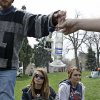 Marijuana smokers pass a bong at the Denver 4/20 pro-marijuana rally at Civic Center Park in Denver on Saturday, April 20, 2013. Authorities generally look the other way at public pot smoking here on April 20. Police said this week they\'re focused on crowd security in light of attacks that killed three at the finish line of the Boston Marathon. (AP Photo/Brennan Linsley)