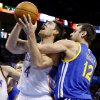 Oklahoma City\'s Nick Collison (4) is fouled by Golden State\'s Andrew Bogut (12) during an NBA basketball game between the Oklahoma City Thunder and the Golden State Warriors at Chesapeake Energy Arena in Oklahoma City, Friday, Jan. 17, 2014. Photo by Bryan Terry, The Oklahoman