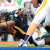 Photo -   West Virginia running back Shawne Alston (20) dives in for a touchdown against Marshall during an NCAA college footbal game in Morgantown, W.Va., Saturday, Sept. 1, 2012. (AP Photo/Christopher Jackson)