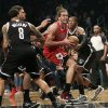Chicago Bulls\' Joakim Noah, second from right, tries to get through Brooklyn Nets defense, including Joe Johnson, right, during the first quarter of Game 1 of a first-round series of the NBA basketball playoffs, Saturday, April 20, 2013, in New York. (AP Photo/Seth Wenig)