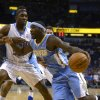 Denver Nuggets guard Ty Lawson, right, drives past Orlando Magic guard E\'Twaun Moore during the first half of an NBA basketball game in Orlando, Fla., Friday, Nov. 2, 2012. (AP Photo/Phelan M. Ebenhack)