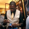 Oklahoma City Thunder\'s Kevin Durant signs an autograph during the KD 35 Ball benefiting the Kevin Durant Family Foundation at the Skirvin Hilton Hotel in Oklahoma City, Saturday, March 31, 2012. (AP Photo/The Oklahoman, Sarah Phipps) ORG XMIT: OKOKL103