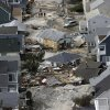 This aerial photo shows the destroyed homes left in the wake of superstorm Sandy on Wednesday, Oct. 31, 2012, in Seaside Heights, N.J. New Jersey got the brunt of Sandy, which made landfall in the state and killed six people. More than 2 million customers were without power as of Wednesday afternoon, down from a peak of 2.7 million. (AP Photo/Mike Groll) ORG XMIT: NJMG114