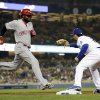 Photo - Los Angeles Dodgers first baseman Adrian Gonzalez, right, takes the throw for the out on Cincinnati Reds' Brandon Phillips during the eighth inning of a baseball game on Wednesday, May 28, 2014, in Los Angeles. (AP Photo/Jae C. Hong)