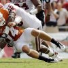 UT\'s David Ash (14) fumbles the ball as he is brought down by Ronnell Lewis (56) of OU in the second half during the Red River Rivalry college football game between the University of Oklahoma Sooners (OU) and the University of Texas Longhorns (UT) at the Cotton Bowl in Dallas, Saturday, Oct. 8, 2011. OU won, 55-17. Photo by Nate Billings, The Oklahoman