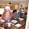 Ann Tubbs, left, a precinct inspector for the Comanche County Election Board, and Doris Recer-Ensley, precinct judge, set up for school board elections Tuesday in Tubbs' living room in Lawton. Photo by Jeff Dixon, Lawton Constitution