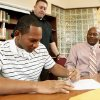 Norman North football player Richard Peoples signs a letter of intent to play college football at East Central on Wednesday, Feb 3, 2010, in Norman, Okla. Behind is Norman North head coach Lance Manning and beside him is his father Richard Peoples, Sr. Photo by Steve Sisney, The Oklahoman