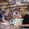 Photo -   Ida Freeman Elementary School Chess Club member Trysta Duerson and Rotarian Sandy Chappell take a break from their game to pose for a photo during the annual Rotary vs. Ida Freeman day. PHOTO PROVIDED  <strong>   -   </strong>
