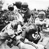 "UNIVERSITY OF OKLAHOMA: ""If you can\'t run around \'em, run over \'em --- and that is just what Sooner freshman Joe Washington does against Kansas State."" Providing a block is teammate Greg Pruitt (30). The Sooners beat the Wildcats by a 52-0 score. Staff photo by Jim Argo taken 10/28/72; photo ran in the 10/29/72 Daily Oklahoman. File: College Football/OU/OU-Kansas State/Joe Washington/1972"