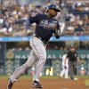 Photo - Atlanta Braves' Justin Upton rounds third after hitting a three-run home run in the third inning of the baseball game against the Pittsburgh Pirates on Tuesday, Aug. 19, 2014, in Pittsburgh. (AP Photo/Keith Srakocic)